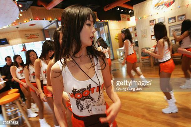 South Korean girls of Hooters undergo training at the Hooters restaurant on January 12 2007 in Seoul South Korea The famous US restaurant is...