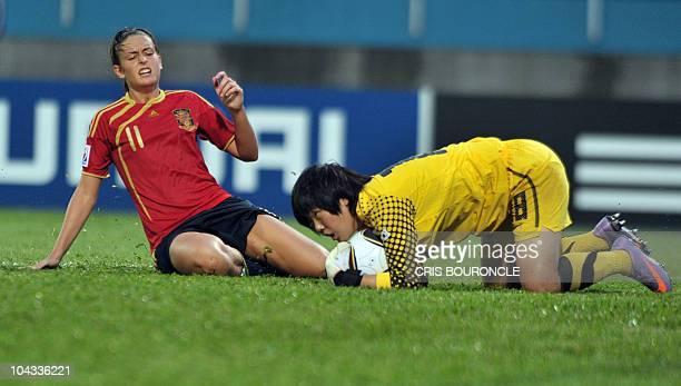 South Korean goalkeeper Danbi Shim grabs the ball shot by Spanish forward Amanda Sampedro during the second half of the FIFA Women's Under17...