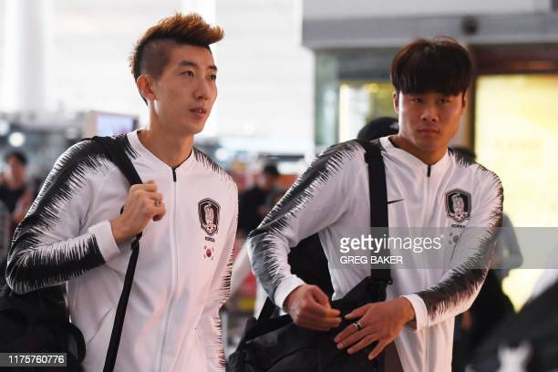 South Korean goalkeeper Jo Hyeonwoo and defender Park Jisoo walk through Beijing airport on October 14 as the football team leaves for Pyongyang via...