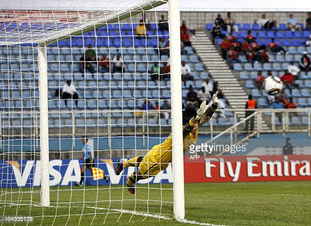 South Korean goalkeeper Kim Minah jumps during the FIFA Women's Under17 semifinal match against Spain on September 21 at the Ato Boldon Stadium in...