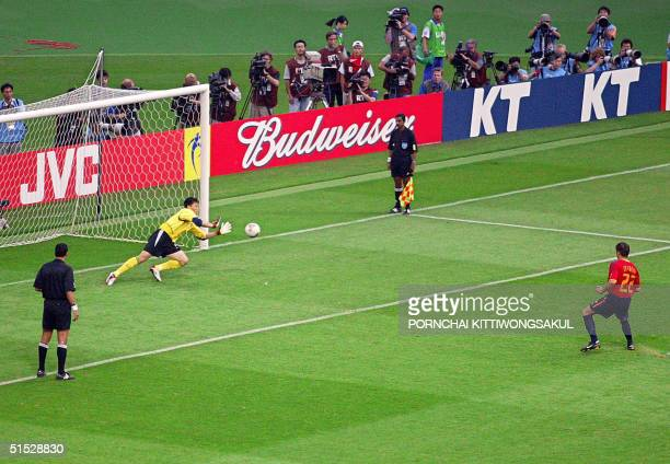 South Korean goalkeeper Lee Woonjae makes a save from Spanish midfielder Joaquin Sanchez during their quarterfinal match at the 2002 FIFA World Cup...