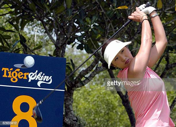 South Korean golfer Grace Park eyes the ball after her teeoff during proam round of Golf Tiger Skins 2005 at Phuket island southern of Thailand 15...