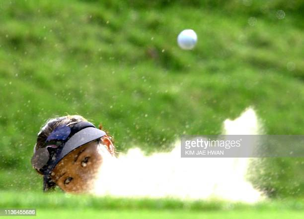 South Korean golfer Grace Park hits out of the bunker in the second round of the LPGA Nine Bridges Classic in Jeju Island 30 October 2004 Park shot...