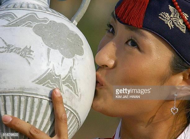 South Korean golfer Grace Park kisses the trophy at the awards ceremony after winning the LPGA Nine Bridges Classic at Jeju Island 31 October 2004...