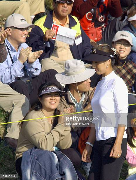 South Korean golfer Grace Park walk pass spectators at the 18th hole of the LPGA Nine Bridges Classic in Jeju Island 31 October 2004 Park won the...
