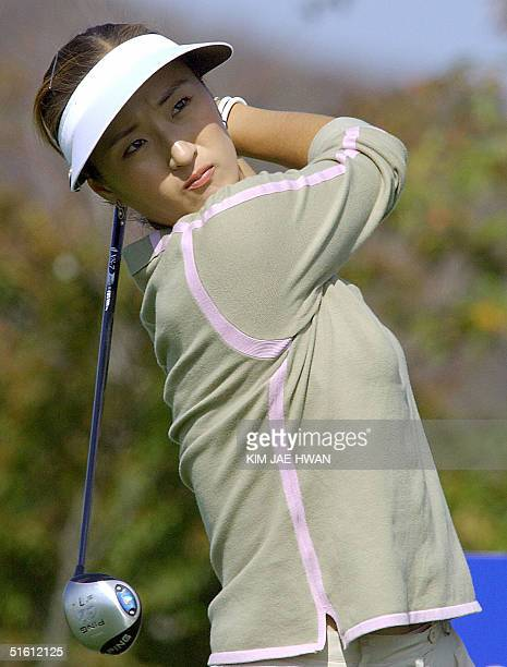 South Korean golfer Grace Park watches her shot on the 18 hole in the first round of the LPGA Nine Bridges Classic in the Jeju Island 29 October 2004...