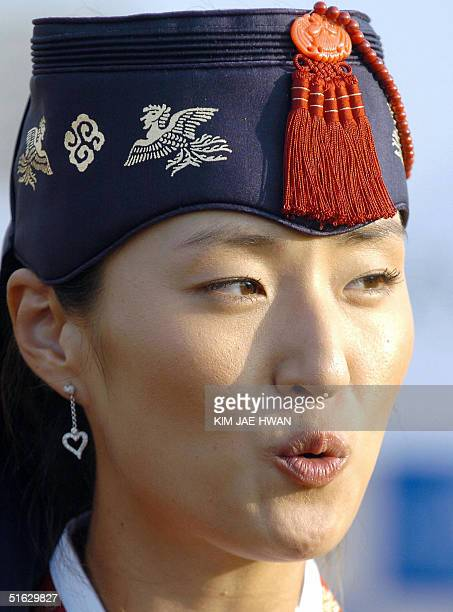 South Korean golfer Grace Park wearing a traditional Korean dress reacts during the awards ceremony to winning the LPGA Nine Bridges Classic at Jeju...