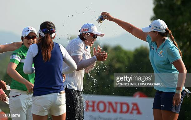 South Korean golfers congratulate compatriot Amy Yang after the final round of the Honda LPGA Thailand 2015 golf tournament in Pattaya on March 1...