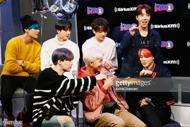 South Korean group BTS enjoy churros during a taping of The Morning Mash Up' On SiriusXM Hits 1 Channel at SiriusXM Studios on April 12 2019 in New...