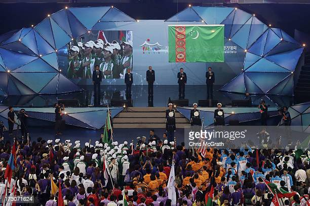 South Korean honor guard raise the Turkmenistan flag, the next host city of the Asian Indoor & Martial Arts Games during the closing ceremony of the...