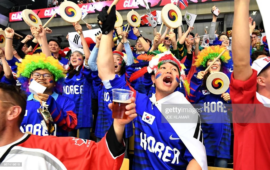 South Korean ice hockey fans celebrate their team's goal to 1:0 during the group B match USA vs South Korea of the 2018 IIHF Ice Hockey World Championship at the Jyske Bank Boxen in Herning, Denmark, on May 11, 2018.