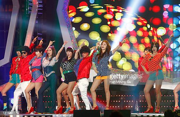 South Korean idol girl group Tara perform on stage at the 2011 Nongshim Sharing Love Concert at Olympic Gymnasium on November 6 2011 in Seoul South...