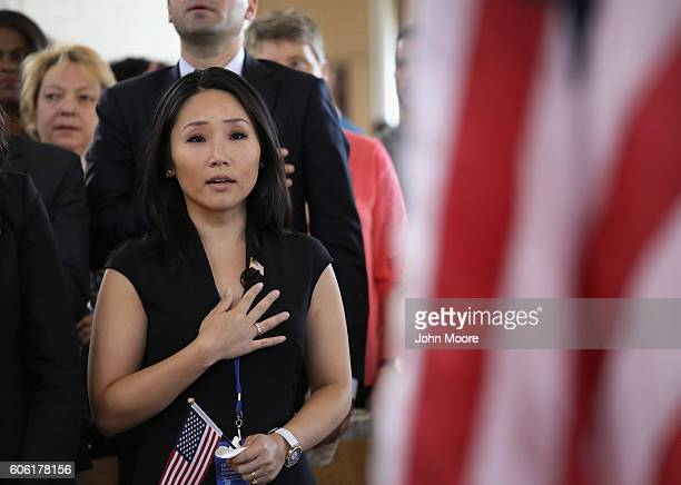 South Korean immigrant and CNN reporter MJ Lee recites the Pledge of Allegiance during a naturalization ceremony in the Great Hall of Ellis Island on...