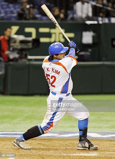 South Korean infielder Kim TaeKyun hits a tworun home run in the third inning against Japan's Seibu Lions during their exhibition game ahead of the...
