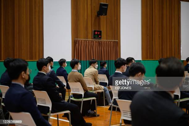 South Korean Jehovah's Witnesses who are conscientious objectors to mandatory military service, await an induction session at a correctional facility...