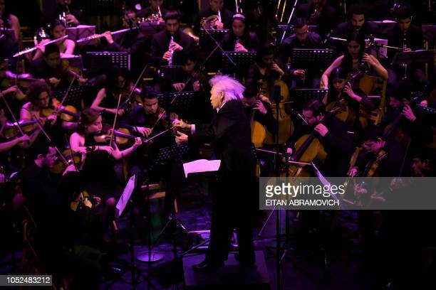 South Korean Jooyong Ahn directs the Latin Vox Machine orchestra at a theater in Buenos Aires on October 09 2018 Latin Vox Machine is an orchestra of...