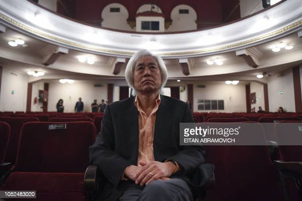 South Korean Jooyong Ahn looks at the Latin Vox Machine orchestra as it rehearses at a theater in Buenos Aires on October 09 2018 Latin Vox Machine...