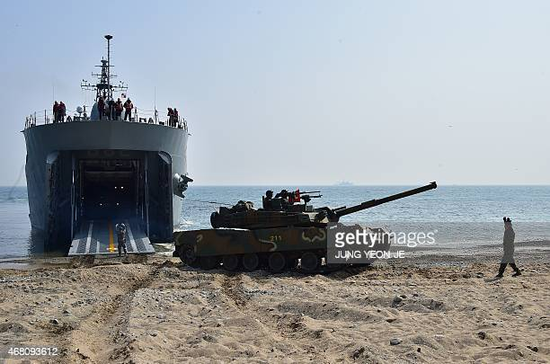 A South Korean K1 tank disembarks from a landing ship tank ship on a beach during a joint landing operation by US and South Korean Marines in the...