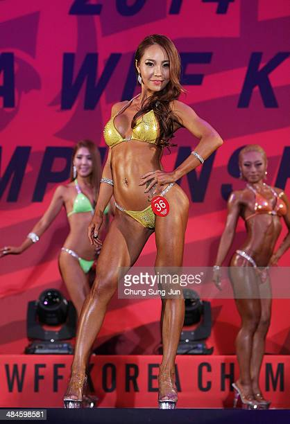 South Korean Kim HyeYoung performs in the WFF Miss Bikini competition during the 2014 NABBA/WFF Korea Championship on April 13 2014 in Daegu South...