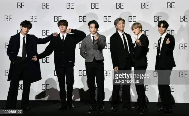 South Korean K-pop boy band BTS members V, Jin, Jung Kook, RM, Jimin and J-Hope pose for a photo session during a press conference on BTS new album...