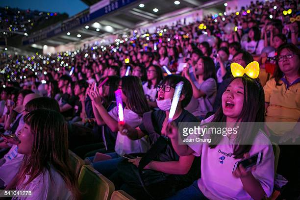 South Korean KPop fans mostly of a boy band called Exo cheer as a KPop band perform on stage on June 18 2016 in Suwon South KoreaThe particular...
