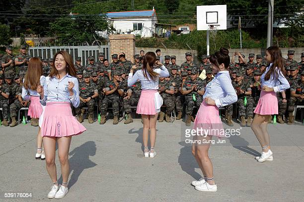 South Korean Kpop girl group Laboum perform for marines at marine's base on June 10 2016 in Gimpo South Korea South Korea's Ministry of National...