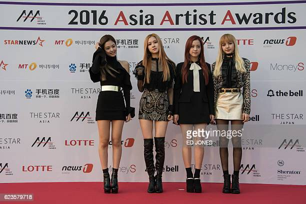 South Korean Kpop group 'Black Pink' pose on the red carpet of the '2016 Asia Artist Awards' in Seoul on November 16 2016 The Asia Artist Awards aims...