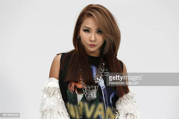 South Korean KPop singer CL from 2NE1 poses upon arrival prior to attend Chanel 2014/2015 Haute Couture FallWinter collection fashion show on July 8...