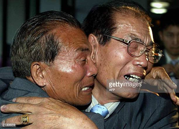 South Korean Kwon Ohkyun cries as he hugs his North Korean brother Kwon Ohkil during a family reunion at a North Korean resort hotel in Mount Kumgang...