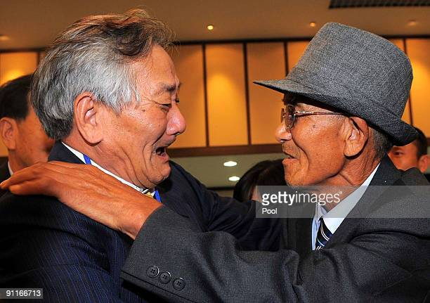 South Korean Lee JungHo meets his North Korean brother Lee KhoiSuk during a separated family reunion meeting at the Mount Kumgang resort on September...