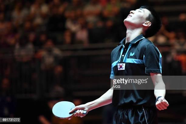 South Korean Lee Sangsu celebrates during Men's Singles third round match against Zhang Jike of China on day 5 of World Table Tennis Championships at...