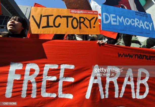 South Korean liberal activists stage a rally supporting the prodemocracy movement taking place in Arab countries in downtown Seoul on February 21...