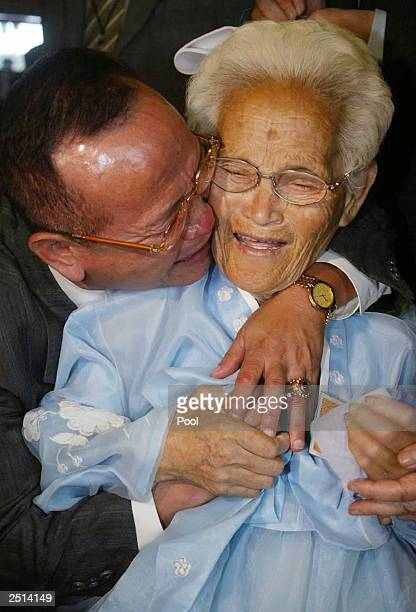 South Korean Lim Sukjoo hugs his North Korean mother Park Oksoon during a separated family reunion September 20 2003 at a hotel of the Diamond...