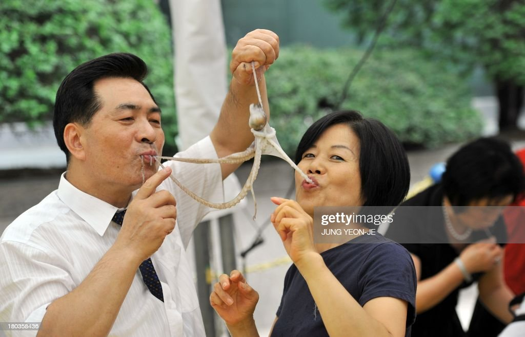 A South Korean Man And A Woman Eat A Live Octopus During An Event