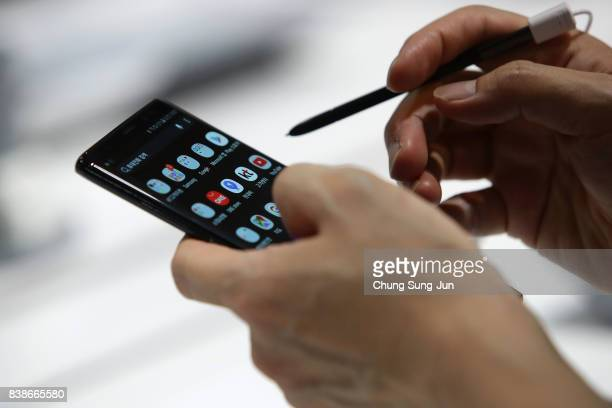 South Korean man experience Samsung Electronics Galaxy Note 8 smartphone at its shop on August 25 2017 in Seoul South Korea Prosecutors are seeking a...