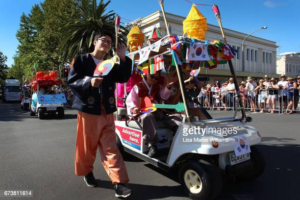 South Korean man makes his way along Peel Street during the annual Tamworth Country Music Festival Cavalcade on January 28 2017 in Tamworth Australia...