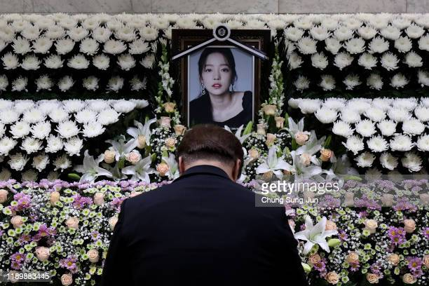 South Korean man pays tribute at a memorial altar as his makes a call of condolence in honor of the Kpop star Goo Hara at the Seoul St Mary's...