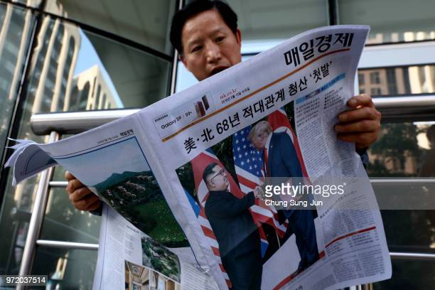 South Korean man reads a newspaper reporting the US President Trump meeting with North Korean leader Kim Jongun on June 12 2018 in Seoul South Korea...