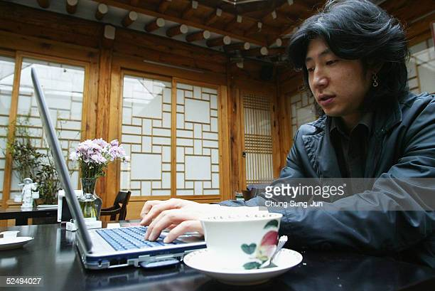 South Korean man use wireless internet at a coffee shop on March 30 2005 in Seoul South Korea South Korea's Ministry of Information and Communication...