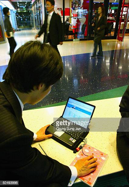 South Korean man use wireless internet in the street on March 30 2005 in Seoul South Korea South Korea's Ministry of Information and Communication...