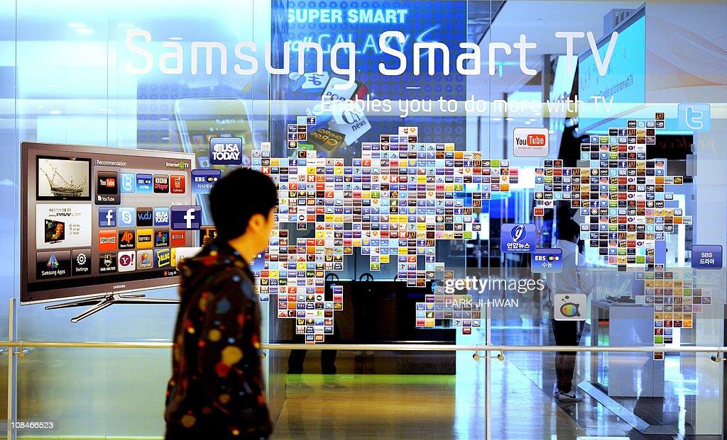 A South Korean man walks past a Samsung : News Photo