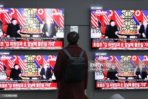 South Korean man watchs screen reporting on the US President Trump meeting with North Korean leader Kim Jongun on February 28 2019 in Seoul South...