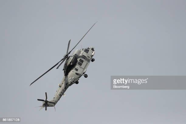 A South Korean Marine Corps KUH1 Surion utility helicopter manufactured by Korea Aerospace Industries Ltd performs maneuvers during a press day of...