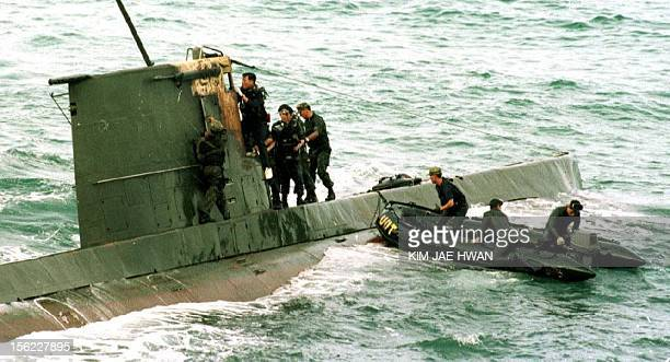 South Korean marine corps search a North Korean combatclass submarine after its discovery on the northeast coast of South Korea some 20 Kilometers...