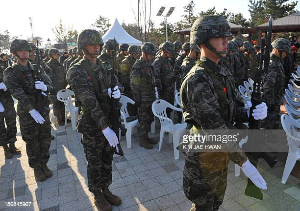 South Korean marine soldiers attend a commemoration ceremony to mark the second annivesary of North Korea's bombing on Yeonpyeong island that left...