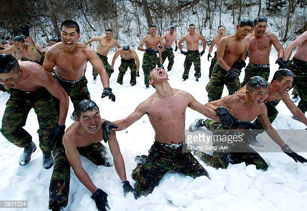 South Korean marine soldiers hurl snow at one another during an exercise against possible North Korea's attack January 29 2004 in Yongpyong South...