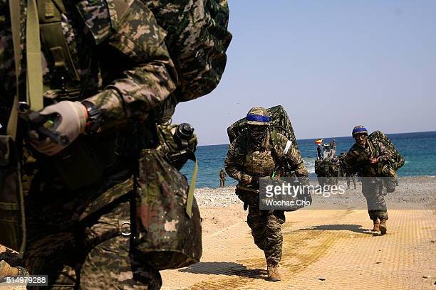 South Korean Marines participate in the US and South Korean Marines joint landing operation at Pohang seashore on March 12 2016 in Pohang South Korea...