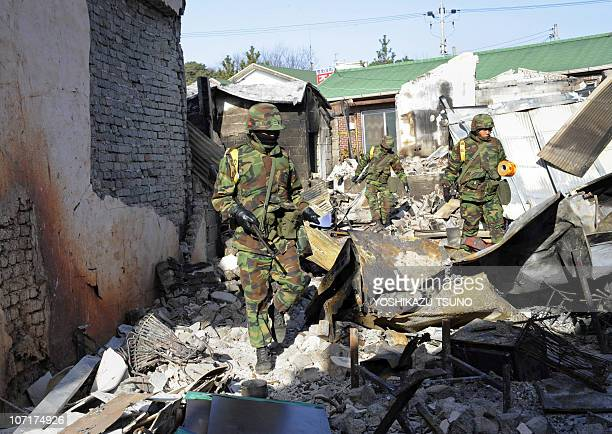 South Korean Marines patrol a damaged area on Yeonpyeong island on November 28 2010 five days after the North stunned the world by launching a...