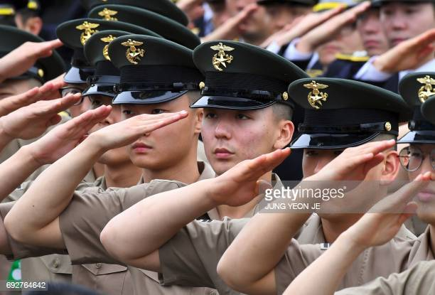 South Korean Marines salute during a ceremony to mark Korean Memorial Day at the National Cemetery in Seoul on June 6 2017 South Korea marked the...