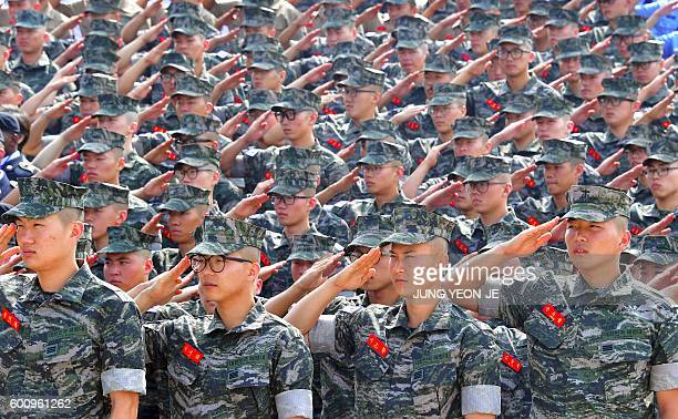South Korean marines salute during a ceremony to mark the 66th anniversary of the start of Operation Chromite the battle that turned the tide in the...